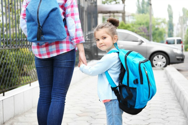 Parent taking child to school